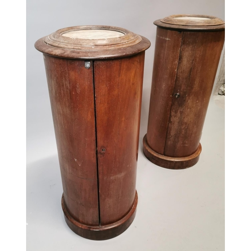 44 - Pair of 19th. C.  mahogany pot cupboards with single door and inset marble tops {88 cm H x 40 cm Dia...