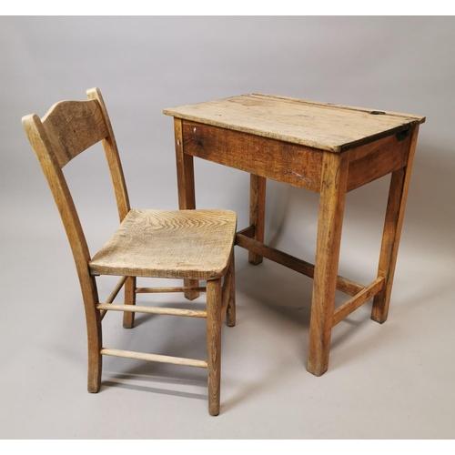 49 - 1950's pine child's desk {66 cm H x 61 cm W x 43 cm D} and matching chair...