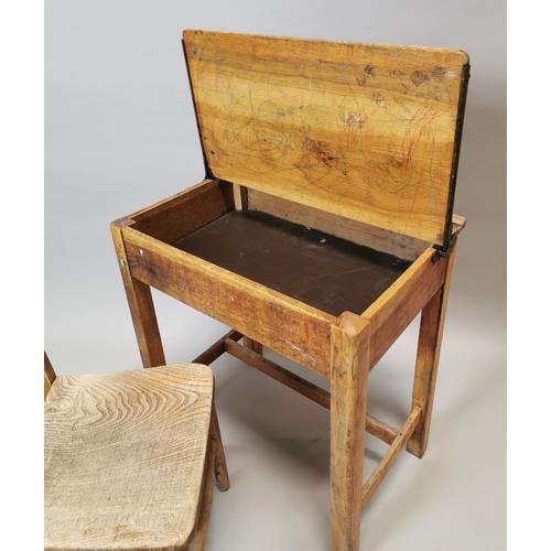 49 - 1950's pine child's desk {66 cm H x 61 cm W x 43 cm D} and matching chair