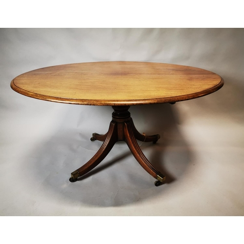 1 - Regency mahogany breakfast table on turned column on four outswept feet. {72 cm H x 135 cm L}...