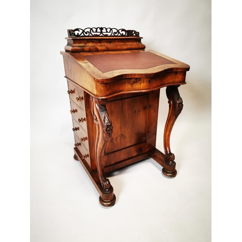 14 - Victorian walnut davenport with fitted maple interior on carved supports. {93 cm H x 56 cm W x 58 cm...