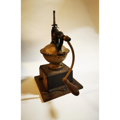 15 - Early 20th C. brass and cast iron coffee grinder. {48 cm H x 42 cm W x 27 cm D}...