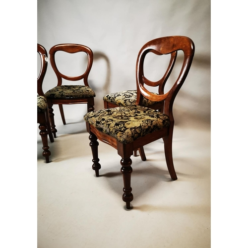 2 - Set of four balloon backed mahogany dining chairs on turned legs with upholstered seats. { 84 cm H }...