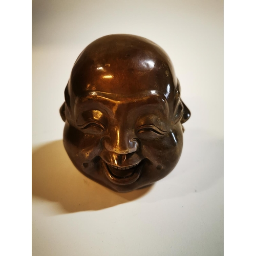 21 - Bronze paper weight in the form of a Buddha. {11 cm H x 12 cm Diam}...