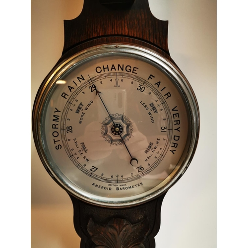 48 - Edwardian carved oak barometer with silvered dial {81 cm H x 26 cm W}....