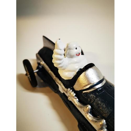 8 - Cast iron Michelin tyres model of car. { 9 cm H x 26 cm L x 10 cm D}...