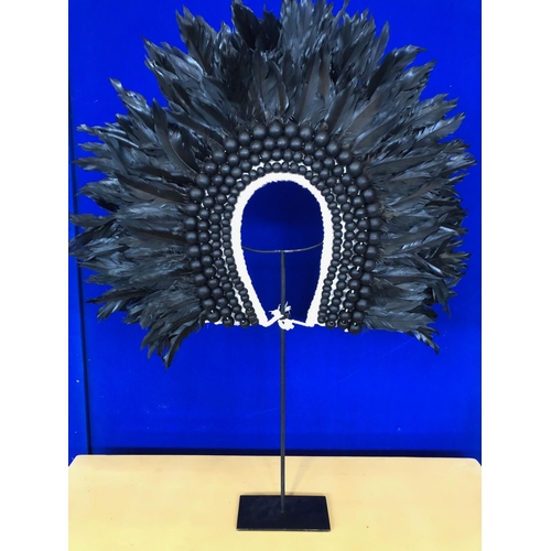 29 - Beaded and feathered headdress W 55 H 40...