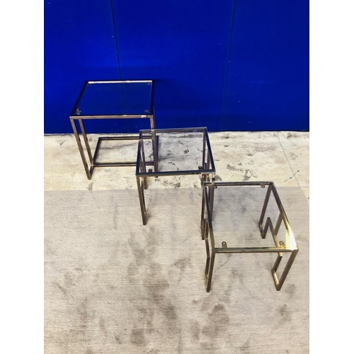 32 - Asian design nest of three chrome tinted tables W 48 H 50 D 48...