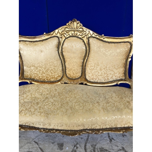 36 - 19th Century gilt three seater couch, standing on cabriole legs W 130 H 100 D 50...
