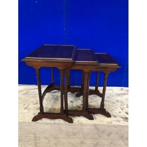 40 - Nest of three mahogany tables W 55 H 60 D 38...