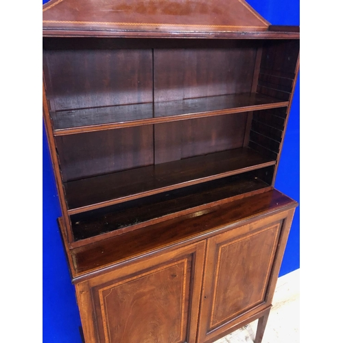 46 - Edwardian inlaid mahogany open bookcase, the arched top above open shelving on cupboard base standin...