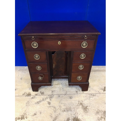 47 - Georgian mahogany knee hole desk, with pull out writing slide, above drawer arrangement on bracket f...