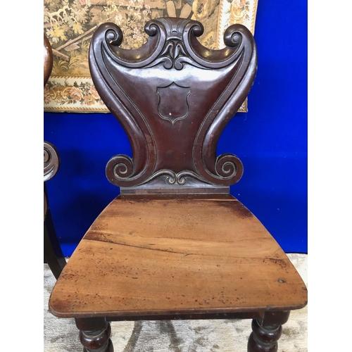 53 - Two Victorian mahogany hall chairs ....