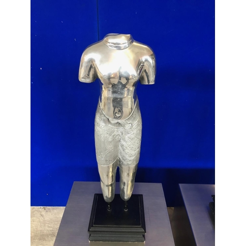 6 - Pair of aluminium semi clad sculptures of the male and female form, standing on black W 23 H 75 D 19...