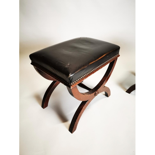 11 - Pair of mahogany and leather upholstered footstools {41 cm H x 46 cm W x 33 cm D}.