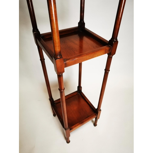 12 - Walnut three tiered whatnot on turned supports {131 cm H x 31 cm W x 31 cm D}.
