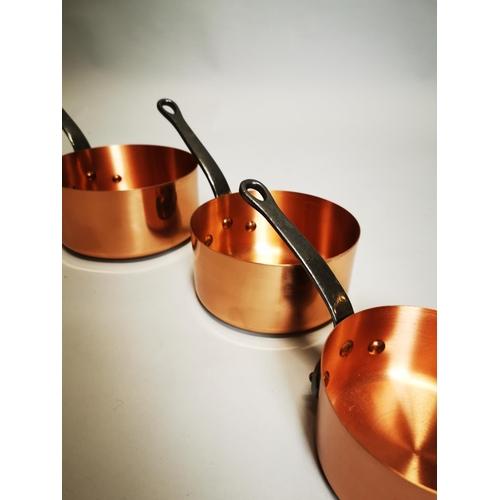 13 - Good quality set of graduated copper saucepans.