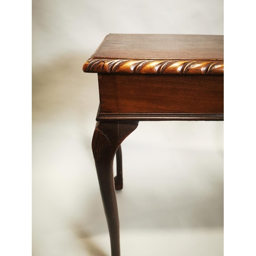 2 - Mahogany side table on ball and claw feet in the Georgian style {78 cm H x 91 cm W x 49 cm D}.