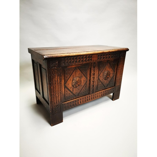25 - Early 20th C. carved oak blanket box {55 cm H x 83 cm W x 43 cm D}.