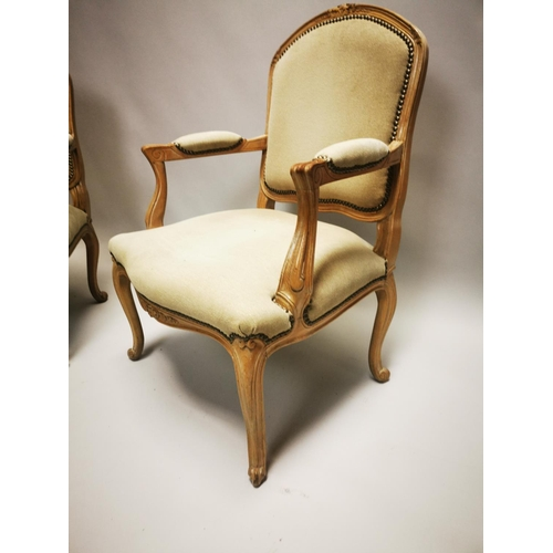 31 - Pair of good quality bleached oak and upholstered French open arm chairs on cabriole legs {90 cm H x...