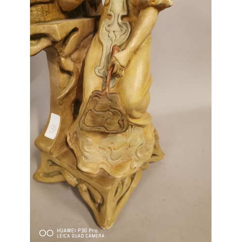 33 - Terracotta figurine of a Lady with mirror in the Art Nouveau style {50 cm H x 17 cm W}.