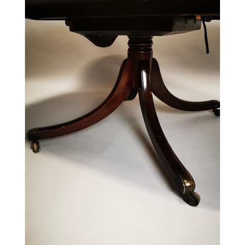 34 - Georgian mahogany coffee table with four outswept legs on brass casters {57 cm H x 151 cm L x 106 cm...