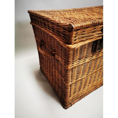 41 - Early 20th C. wicker laundry basket with metal mounts {63 cm H x 106 cm W x 55 cm D}.