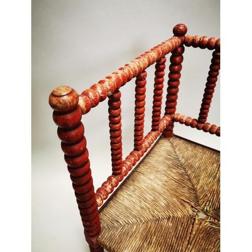 47 - 19th C. painted pine bobbin chair {71 cm H x 57 cm W x 60 cm D}.