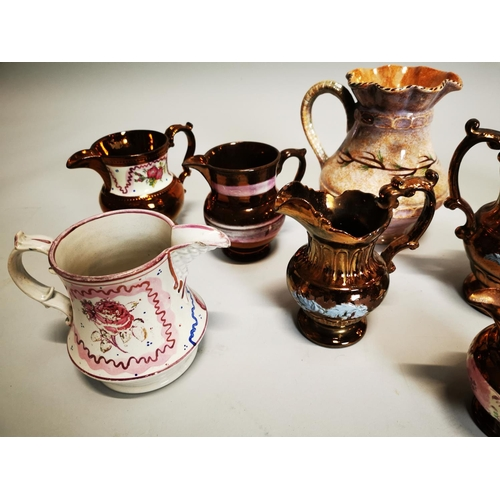 54 - Collection of eight ceramic water jugs.