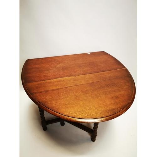 55 - Edwardian oak drop leaf table on barley twist legs {72 cm H x 107 cm W x 54 cm D}.