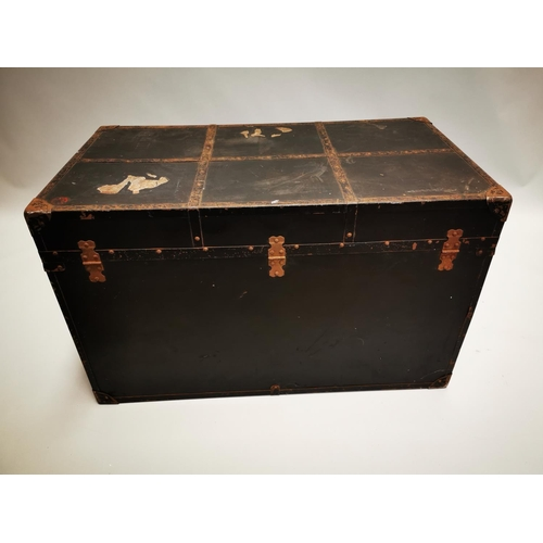 56 - Early 20th C. canvas and metal bound travelling trunk {56 cm H x 92 cm W x 51 cm D}.