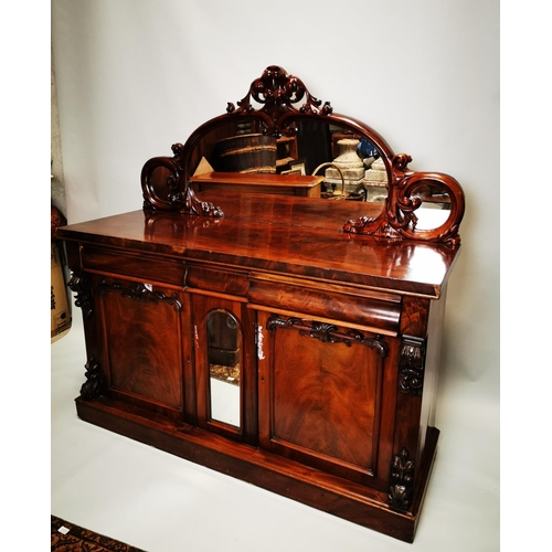 59 - Victorian mahogany mirrored back side board with three drawers in the frieze and two blind doors {16...