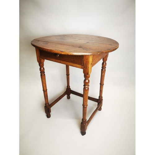 7 - 18th C. oak table on turned legs with single drawer in the frieze {67 cm H x 64 cm Dia.}.