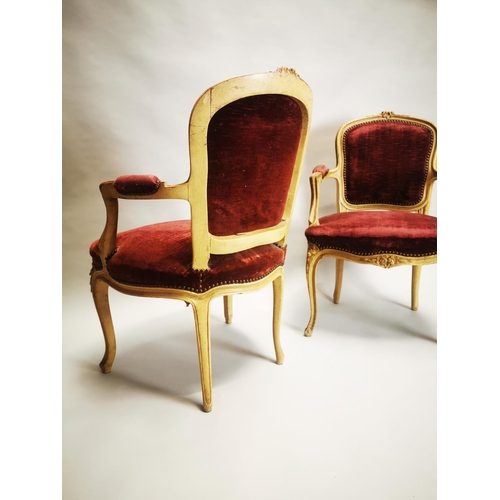8 - Pair of upholstered arm chairs on cabriole legs {85 cm H x 57 cm W x 46 cm D}.