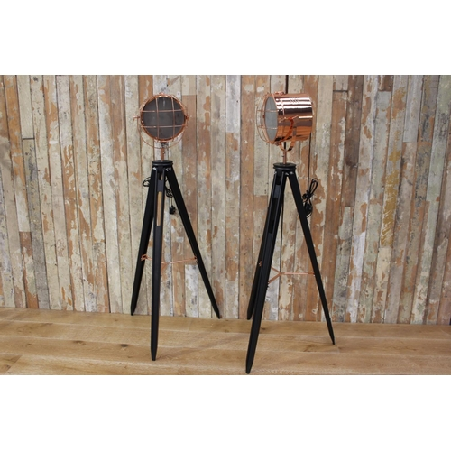 1 - Pair of copper head spot lights mounted on tripod stands. {150 cm H x 50 cm W x 50 cm D}...