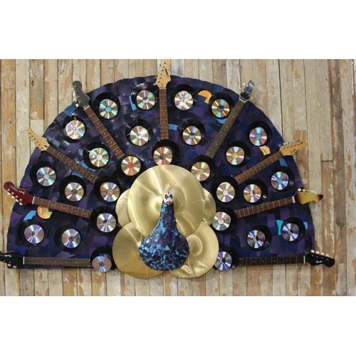 15 - Unusual fan shaped wall art depicting guitars CD's records cymbals and peacock. {140 cm H x 220 cm W...