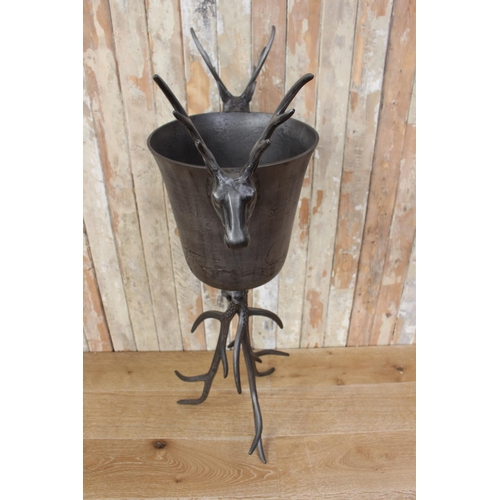 17 - Champagne ice bucket with stag head handles mounted on antler tripod base. {112 cm H x 63 cm W x 36 ...