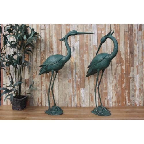 19 - Pair of good quality cast iron models of Storks. { 144 cm H x 30 cm w x 50 cm D each...