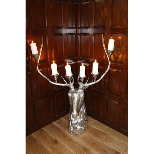 23 - White metal six branch candle holder in the form of a stag's head. { 136 cm H x 35 cm W x 16 cm D}....