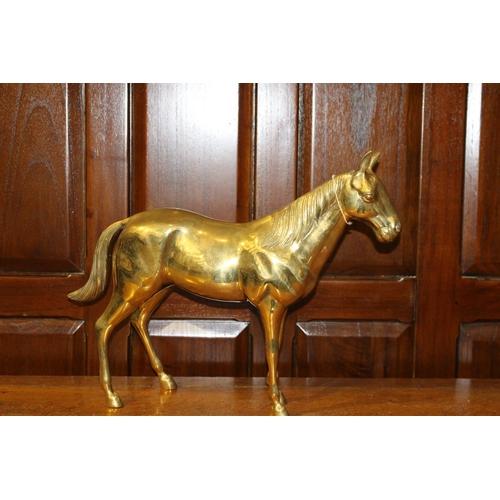 27 - Brass model of horse . { 40 cm H x 52 cm W x 10 cm D}...