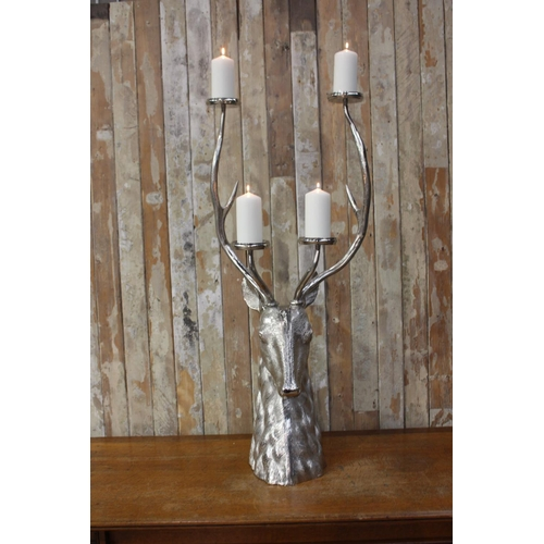 28 - White metal four branch candle holder in the form of a stag's head. { 114 cm H x 50 cm W x 50 cm D}....
