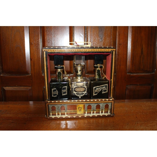 30 - 19th C. Inlaid three bottled tantalus with bone arch decoration and original key. {35 cm H x 35 cm W...