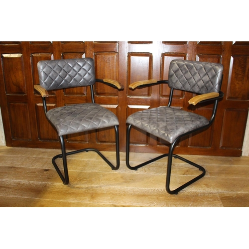 36 - Pair of leather upholstered metal and wood armchairs. { 86 cm h x 58 cm W x 45 cm D}...