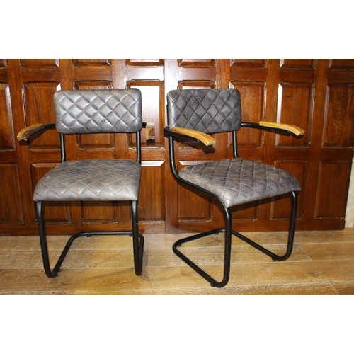 37 - Pair of leather upholstered metal and wood armchairs. { 86 cm h x 58 cm W x 45 cm D}...