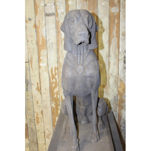 42 - Pair of wooden models of seated Hounds mounted on wooden plinths. { 164 cm H x 48 cm H x 86 cm D}.}...