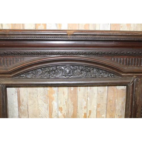 44 - 19th C. cast iron decorative chimney piece. {138 cm H x 180 cm W x 34 cm D}...