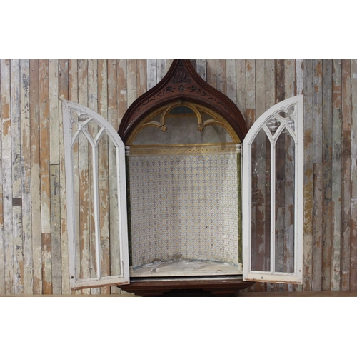 45 - 19th C. pitch pine wall mounted statue cupboard with two glazed doors in the Gothic style. { 236 cm ...