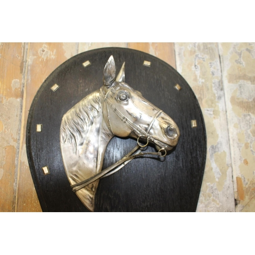 6 - Pair of silver plated horse's heads mounted on horseshoe plaques. {36 cm H x 30 cm}...