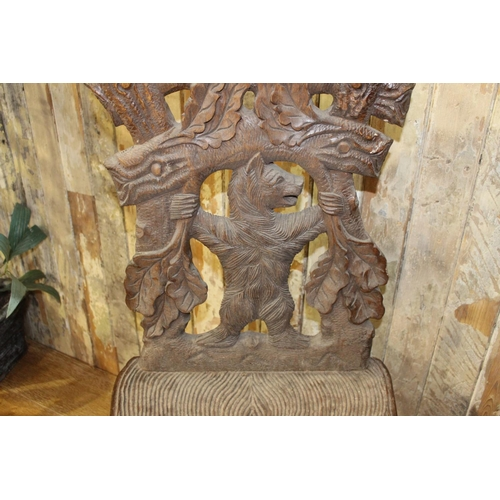 8 - Black Forest chair and bench  - the chair depicting a bear climbing and the bench depicting a bear p...