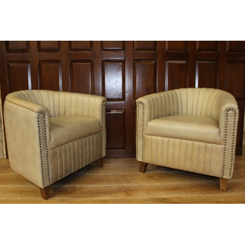 9 - Pair of leather upholstered club chairs. {66 cm H x 70 cm W}...